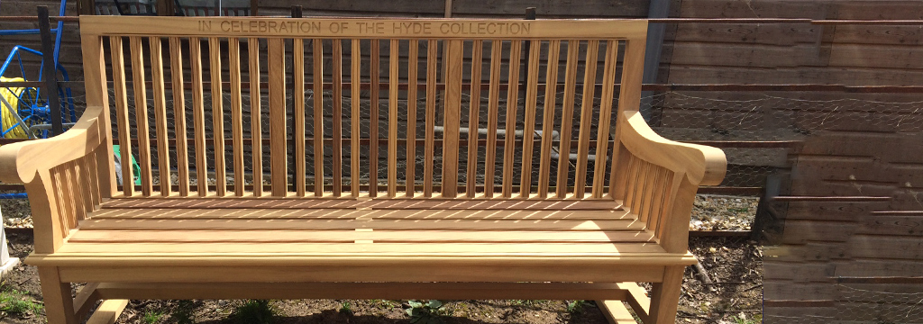 Curved white wooden bench made by the Granton Team