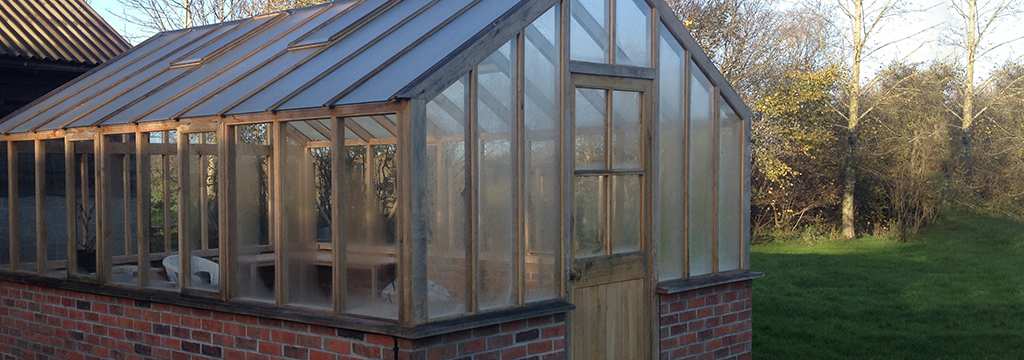 A white plastic and glass conservatory made by Granton Joinery